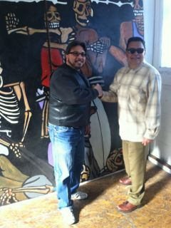 Carlos Gonzales (R) and Ray Balberan celebrate the return of two lost 1980s mural panels
